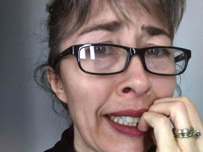 Heidi Schreiner looking nervous and biting her fingernails